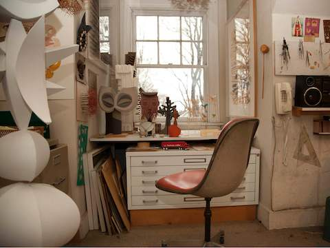 Harper's workspace looks much the same after decades of use.