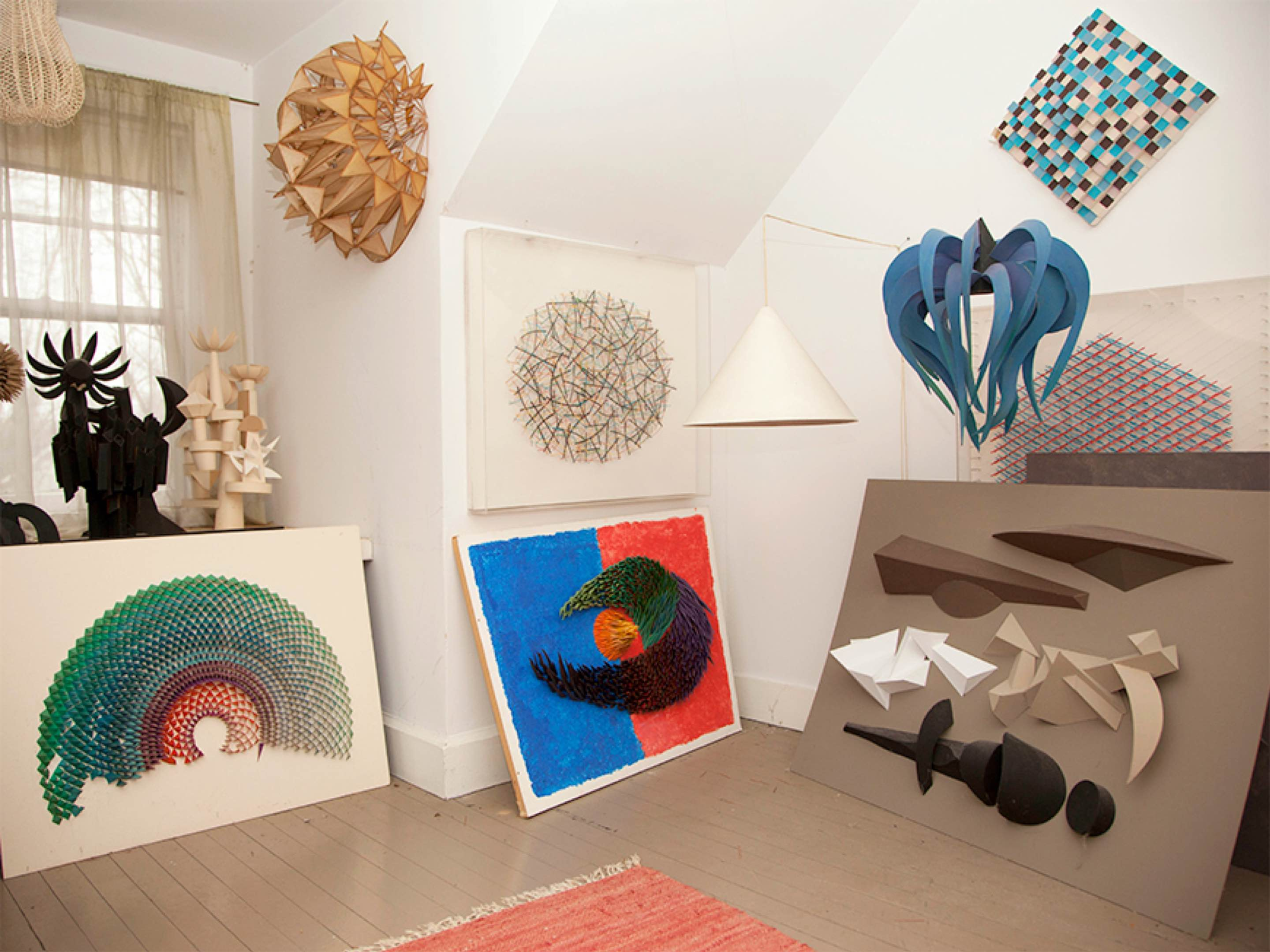 Various pieces of artwork on display in designer Irving Harper's home.