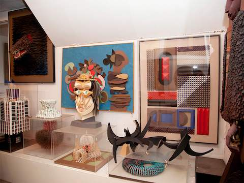 Sculptures created from various media on display in designer Irving Harper's home.