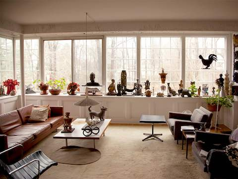 Sculptures created by designer Irving Harper occupy a window seat in the living room of his home.