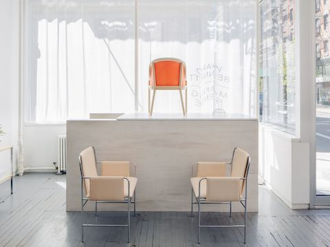 For the installation at Project No. 8, Ward Bennett Landmark Chairs and Envelope Chairs were finished in materials chosen by Various Projects: RAL Luminous Red Leather, Geiger Alpaca Mohair in charcoal, and Vachetta leather.