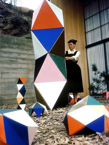 Ray Eames plays with an early prototype of The Toy outside the Eames House in 1951.