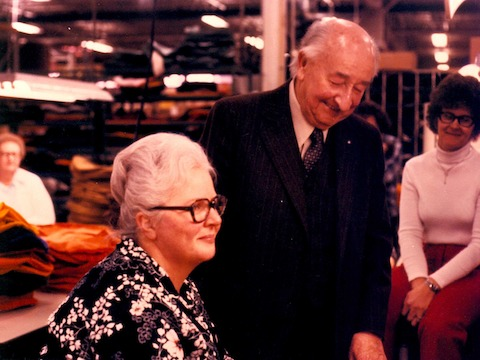 A color photo of Herman Miller founder D.J. De Pree laughing with employees.