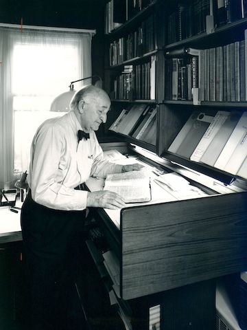 Herman Miller founder D.J. De Pree reads in his home office.