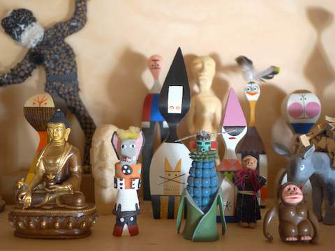 A collection of folk art figurines.