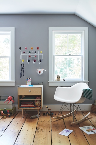 Eames Molded Plastic Rocker, an Eames Hang It All, and a Nelson Thin Edge Storage unit complete this play room.