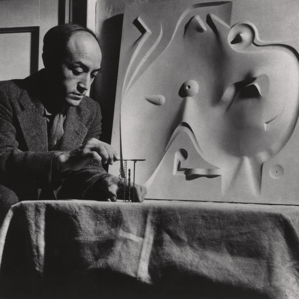 Noguchi with contoured playground model, 1946.