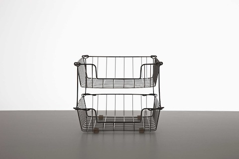 Black in-and-out wire baskets, one stacked on the other.