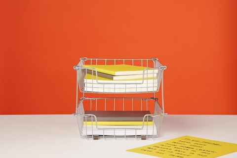 Silver in-and-out wire baskets containing notepads.