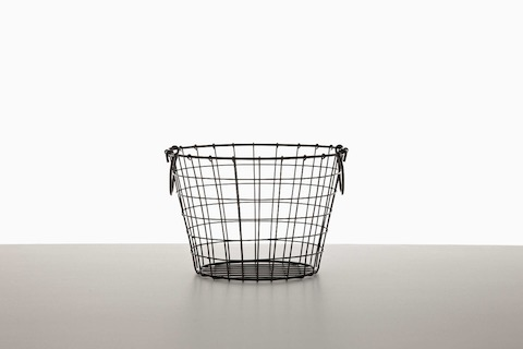 An empty black wire basket.