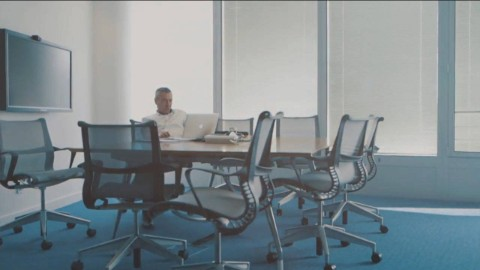 A man works alone in a conference room outfitted with Setu office chairs. Select to play a case study video featuring Citrix.