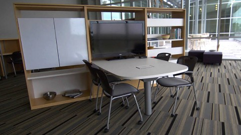An open meeting area with Caper chairs. Select to view a case study video featuring the animal health institute at K-State Olathe.