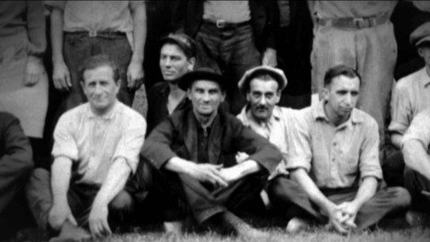 Black and white photograph of the original Herman Miller employees. Select to play a video about the story of the millwright poet.