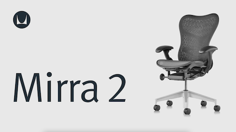 A Mirra 2 ergonomic desk chair with white frame, polished aluminum base, and blue fabric back and seat, viewed from an angle.