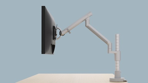 Profile view of an adjustable Flo Monitor Arm with a single monitor attached. Select to view a video about Flo Monitor Arms.