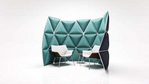 Two Swoop lounge armchairs with white upholstery in an enclave defined by a green Kivo boundary.