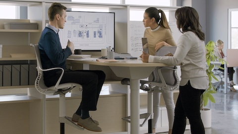 An image of people working at a Canvas Group collaboration space. Select to play video introducing the Canvas Office Landscape family.