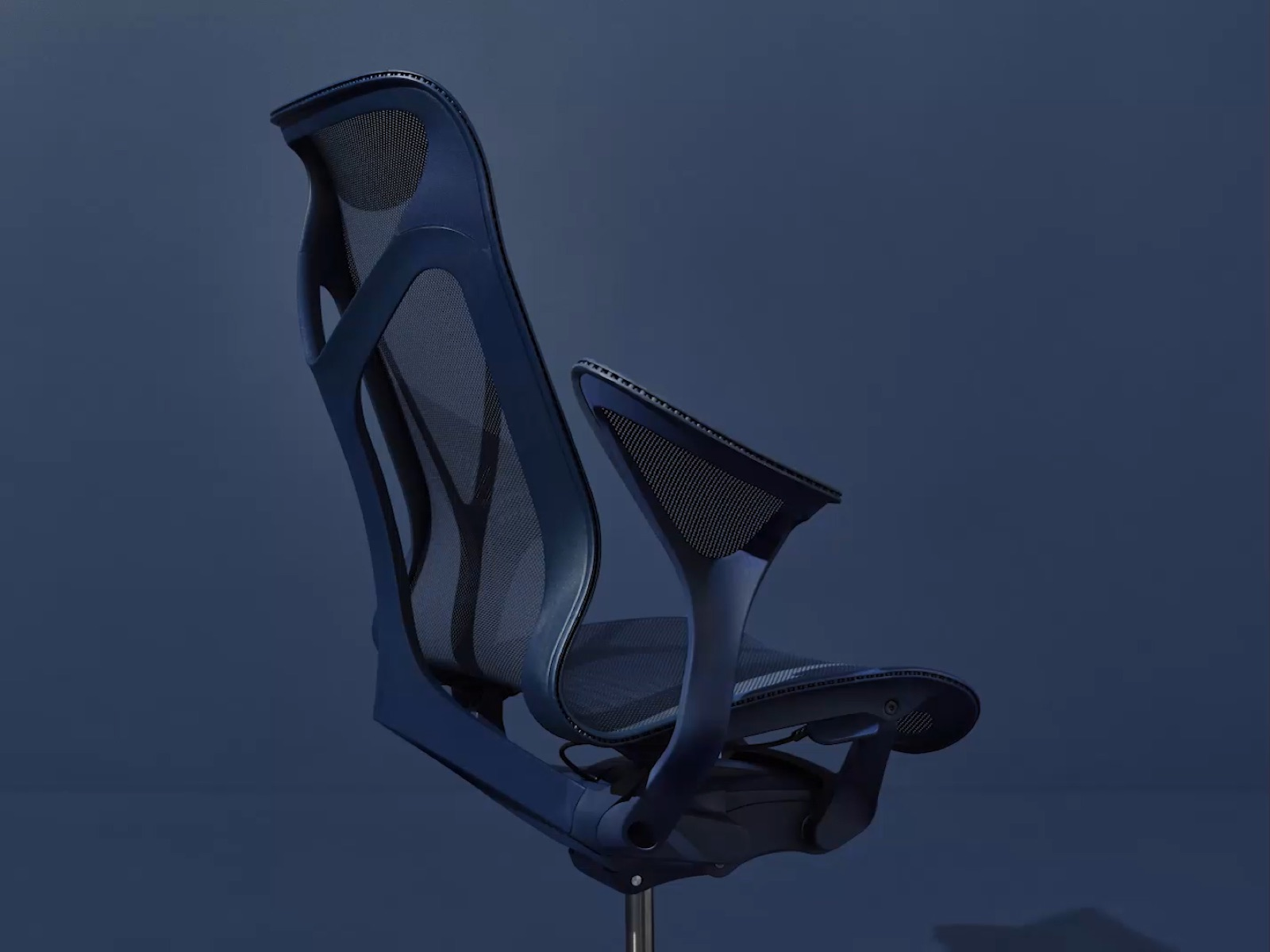 A high-back Cosm office chair with leaf arms in Nightfall dark blue, viewed from an angle.