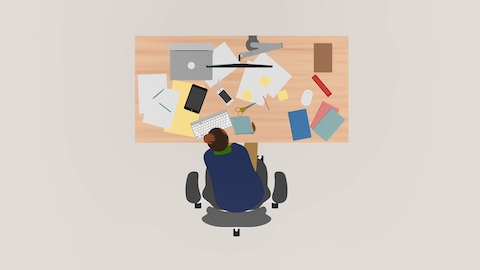 An illustration showing an overhead view of an office worker surveying a cluttered desktop.
