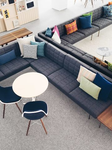 Overhead view of a lounge area anchored by two back-to-back gray Tuxedo sectionals.