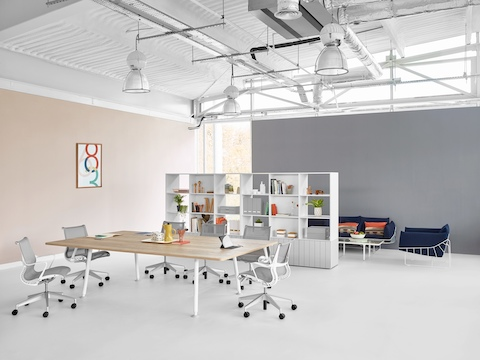 A Locale shelving unit divides a meeting space from a lounge area in an open workplace.