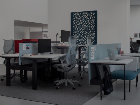 An open office environment offering various seating options for individual work or interaction.