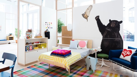 A child's bedroom featuring a blue Wireframe Sofa. Select to find links to Herman Miller authorized retailers.