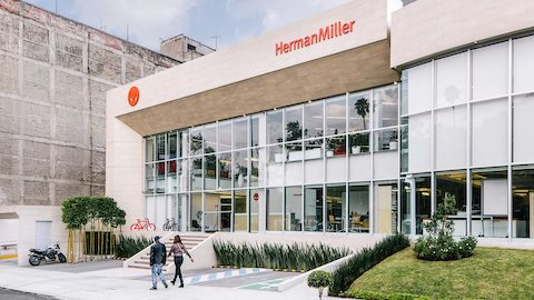 Two people approach the entrance of a Herman Miller showroom. Select to find Herman Miller showrooms around the world.