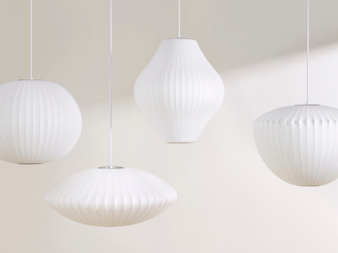Four white hanging Nelson Bubble Lamps.